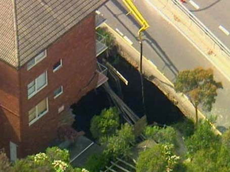 overhead view of hole and damaged unit block
