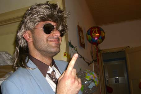 Houmer in costume with mullet wig and sunglasses