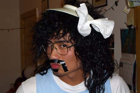 Johnny with duct tape moustache, visor and a bow in his hair
