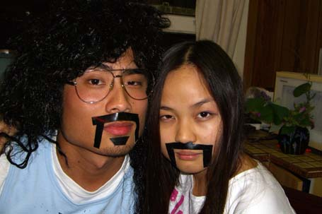 Johnny and Stef with duct tape moustaches