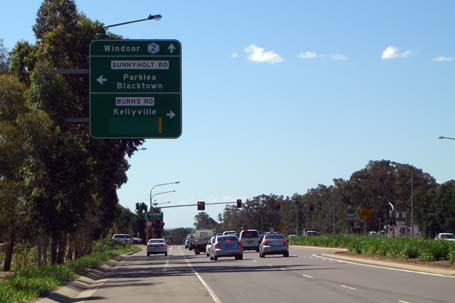 advanced direction sign on OldWindsorRd giving directions for SunnyholtRd and BurnsRd