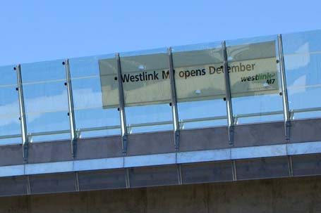 'Westlink M7 opens December' banner hanging on side of M7 viaduct