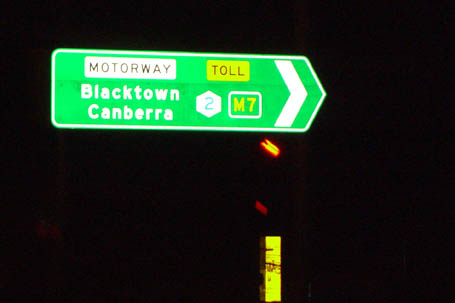 ID signs showing the M2 signed westbound as Metroad 2 and M7, with focal points Blacktown and Canberra