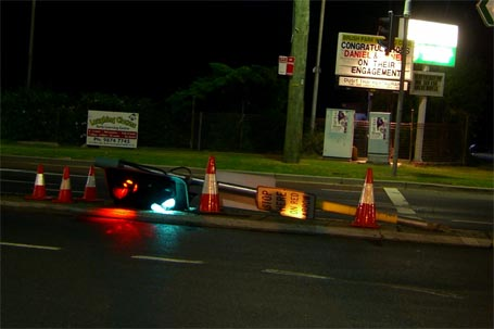 Traffic signals along the median strip knocked down, but still operating